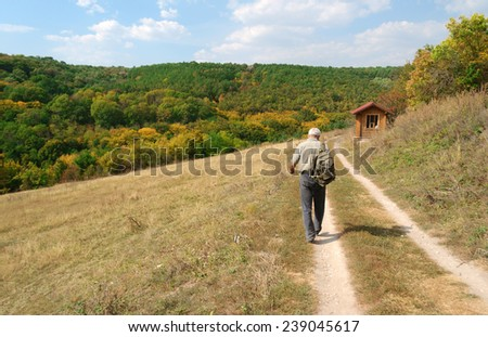 man walking mountain path - stock photo