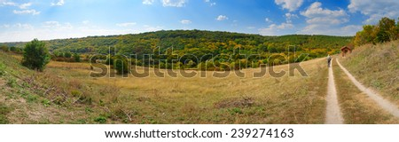 man walking mountain path panorama - stock photo