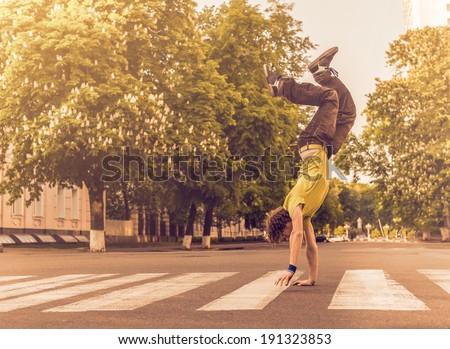 Man walking on hands upside down - stock photo
