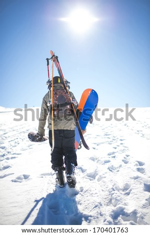 Man walking on snow - stock photo