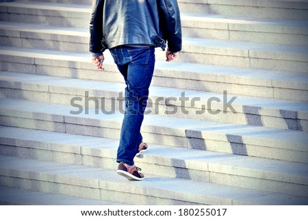 Man walking up the stairs - stock photo
