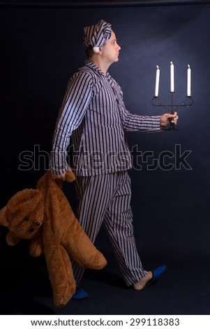 man walking with a candlestick - stock photo