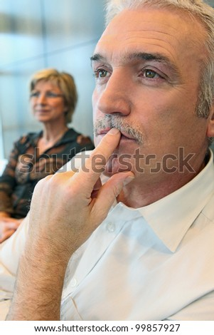 Man watching something thoughtfully - stock photo