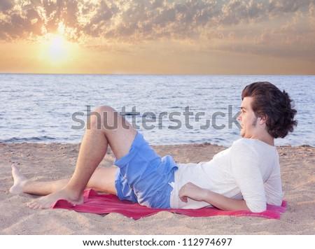 Man watching sunset - stock photo