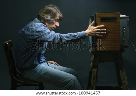 Man watching TV. - stock photo