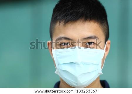 man wear face mask - stock photo