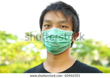man wear mask outdoor - stock photo