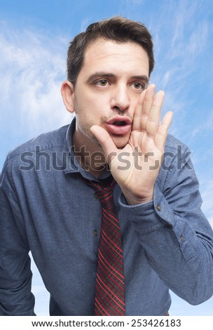 Man wearing a blue shirt and red tie. He is screaming. Over clouds background - stock photo
