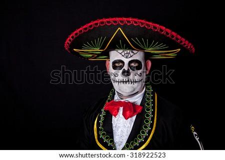 Man wearing a Cinco de Mayo halloween costume - stock photo