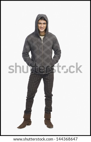 Man wearing a hooded shirt and smiling - stock photo