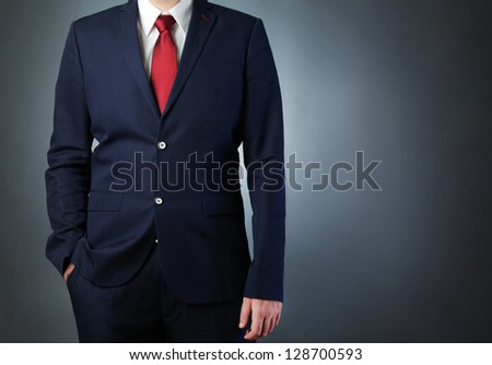 man wearing blue business suit - stock photo