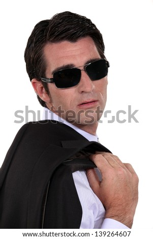 Man wearing dark sunglasses - stock photo