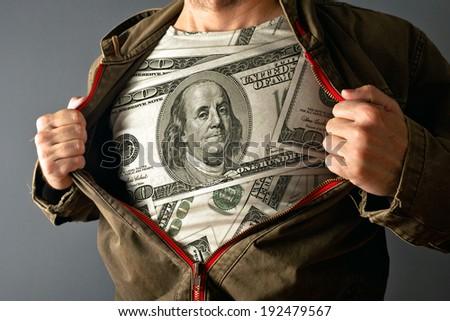 Man wearing dollar shirt. man showing his US dollar shirt under jacket. - stock photo