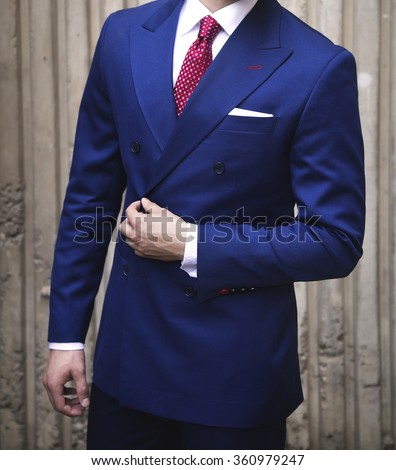 Man wearing double breasted suit - stock photo