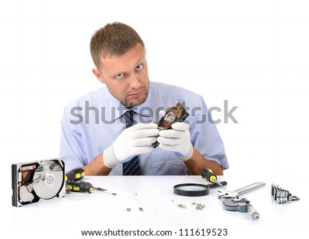 Man wearing gloves repairs hard drive on white background, concept repair computer - stock photo