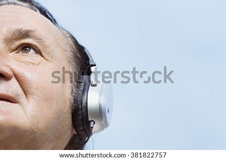 Man wearing headphones - stock photo