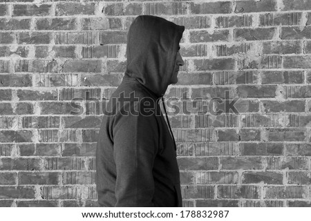 Man wearing hood ,black and white  - stock photo
