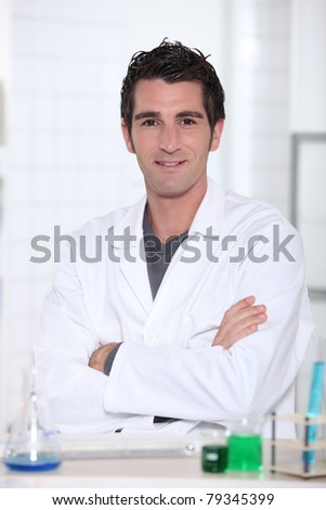 Man wearing lab coat - stock photo