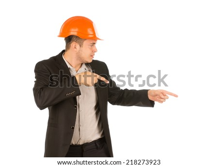 Man Wearing Orange Hard Hat and Suit Jacket Pointing and Looking to the Side - stock photo