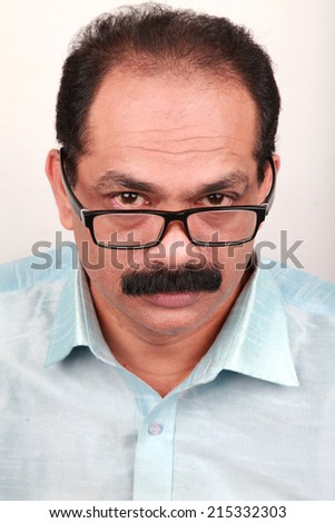 Man wearing spectacles looks up  - stock photo