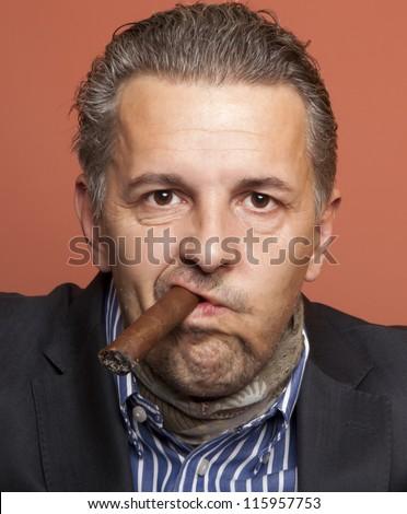 Man wearing suit gangster style smoking cigar - stock photo