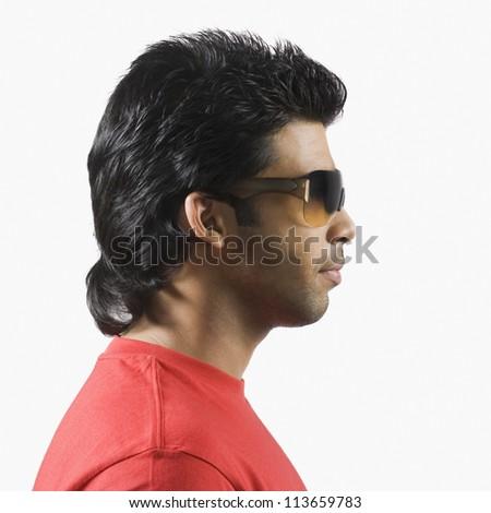 Man wearing sunglasses - stock photo