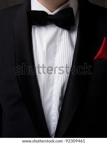 Man wearing tuxedo. - stock photo