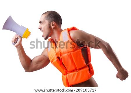 Man wearing vest with loudspeaker - stock photo