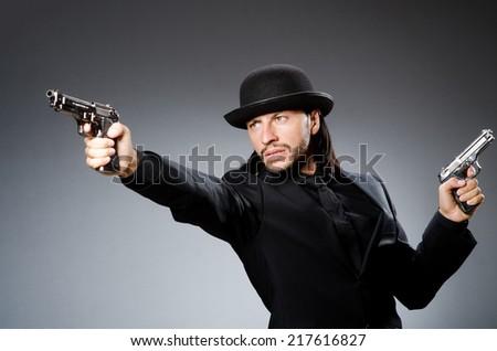 Man wearing vintage hat with gun - stock photo