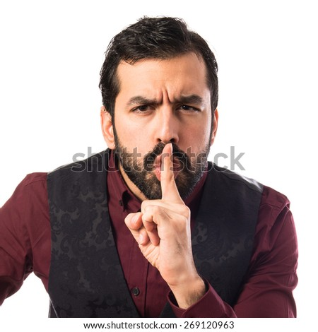 Man wearing waistcoat making silence gesture  - stock photo
