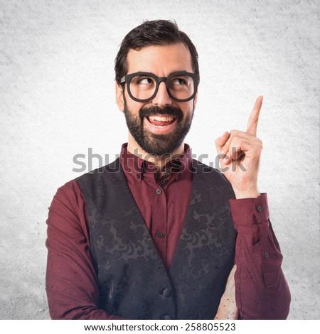 Man wearing waistcoat thinking over textured background   - stock photo