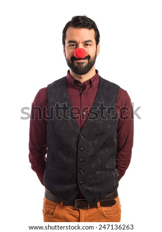Man wearing waistcoat with clown nose  - stock photo