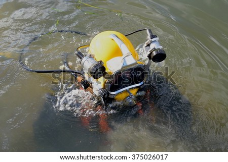 Man wearing yellow environmental protective diving suit  - stock photo