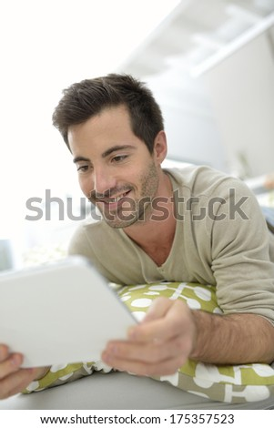 Man websurfing on internet with tablet - stock photo