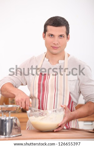 Man whisking batter - stock photo