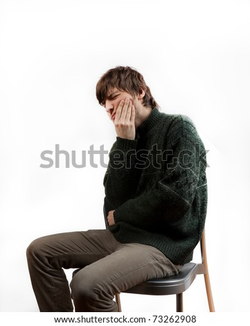 man who suffers by teeth pain - stock photo