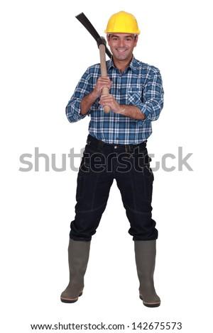Man wielding ax - stock photo