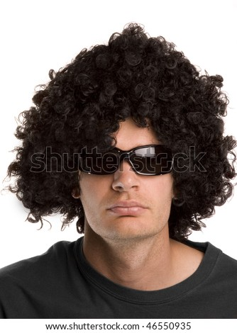 Man with a black curly wig and sunglasses - stock photo