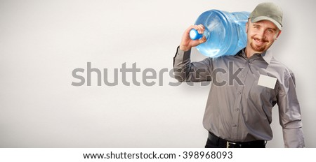 Man with a bottle of drinking water. - stock photo