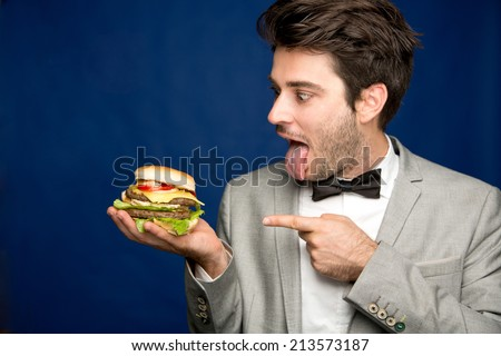 Man with a burger  - stock photo