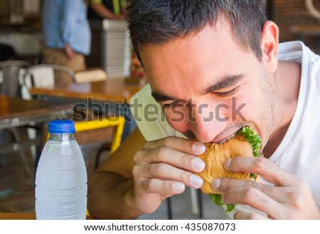 man with a burguer - stock photo