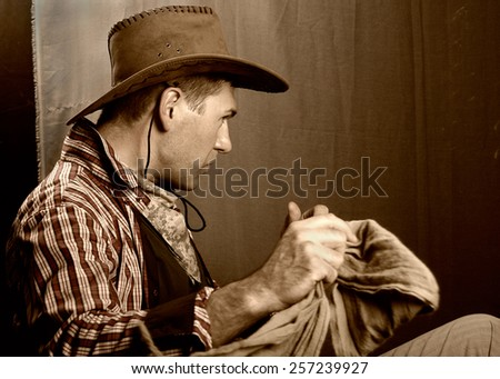 Man with a cowboy hat and scarf - stock photo