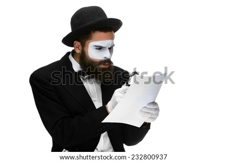 Man with a face mime reading  through a magnifying glass isolated on a white background. concept careful search - stock photo
