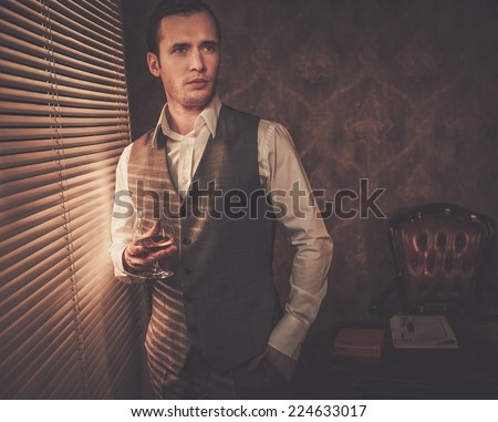 Man with a glass near a window - stock photo