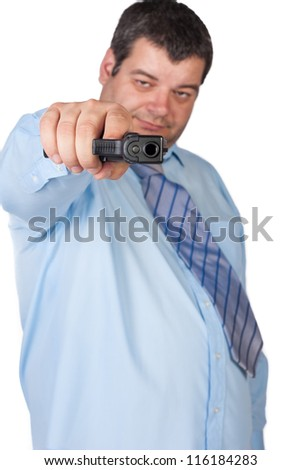 man with a gun ready to shoot (focus on the weapon) - stock photo