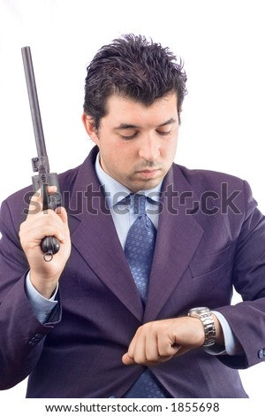 Man with a gun taking a look at a watch - stock photo