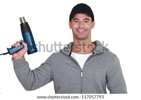 Man with a heat gun - stock photo