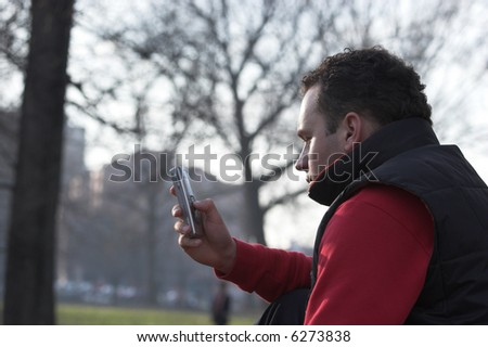 Man with a mobile phone - stock photo