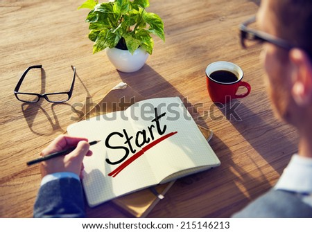 Man with a Note and a Single Word Start - stock photo