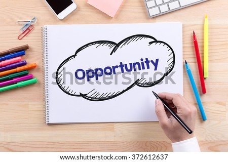 Man with a Notepad written Opportunity Concept - stock photo